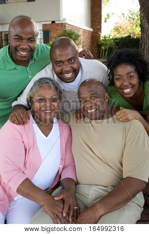 Happy African American couple and their adult kids.