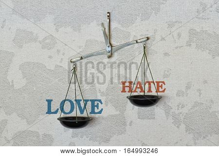 Words Love and Hate and a balance on bright background