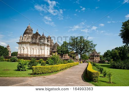 The famous temples of Khajuraho are a large group of medieval hindu and jain temples famous for their erotic sculptures. Situated in Khajuraho Madhya Pradesh India. Unesco world heritage site. Popular amongst tourists all over the world.