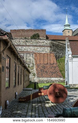 Oslo - the capital of Norway. Clear sunny summer day. Castle and Akershus Fortress. Antique guns.