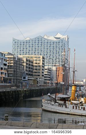 HAMBURG GERMANY - NOVEMBER 14: In background the 110-meter high building stands prominently near the landing bridgeson the Elbe in the west of HafenCity in Hamburg Germany on November 14 2016