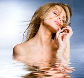foto of beautiful face  - Portrait beautiful young woman in the water - JPG