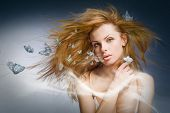 stock photo of young women  - Portrait beautiful young woman with butterfly - JPG
