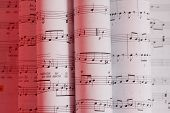 image of musical instruments  - Composition of music notes written on paper - JPG