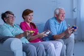 Elderly Couple And Caregiver Playing poster