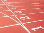 pic of 8-track  - Numbered lanes on a running track - JPG