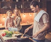 Young Family Cooking poster