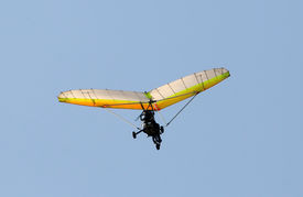 picture of ultralight  - Ultralight airplane in flight against blue sky - JPG