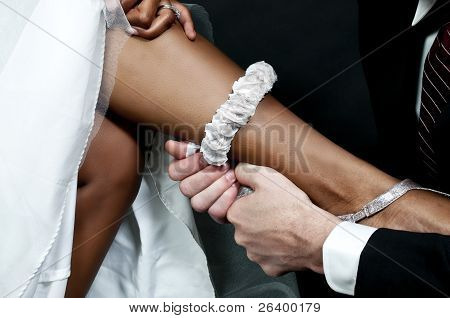 Man With Garter On Black Woman
