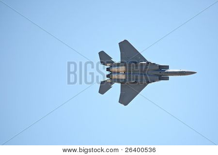 F15 flying directly overhead against clear blue sky