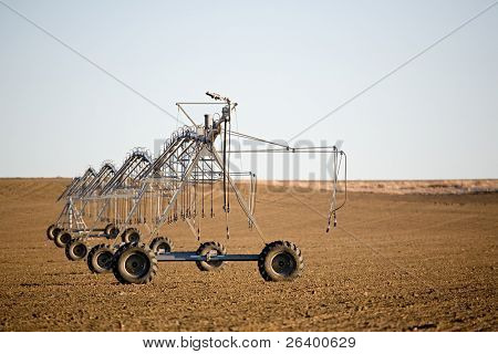 irrigation system lies motionless on a cold, barren field in december