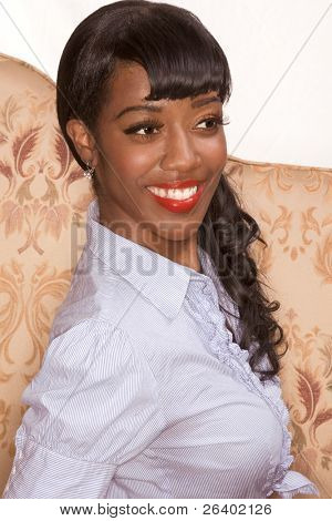 Portrait of happy Afro-American young woman in 50s-60s retro style