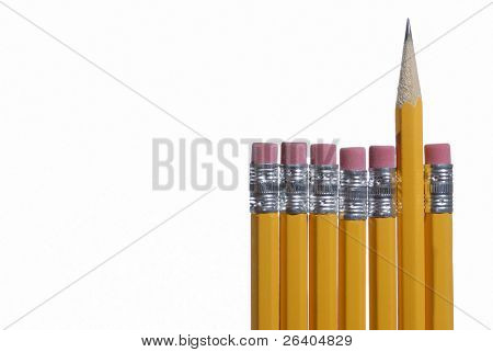 Close up macro of pencil erasers and one point on white background