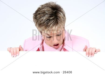 Beautiful Surprised Woman Holding Blank Sign