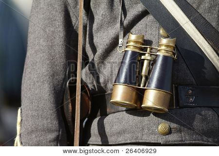Civil War reenactment officer with spyglass and sword