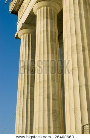Beautiful sun lit building columns background texture with blue sky 02