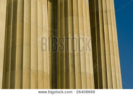 Beautiful sun lit building columns background texture with blue sky 04