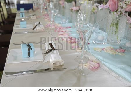 Wedding banquet table with baby blue gifts