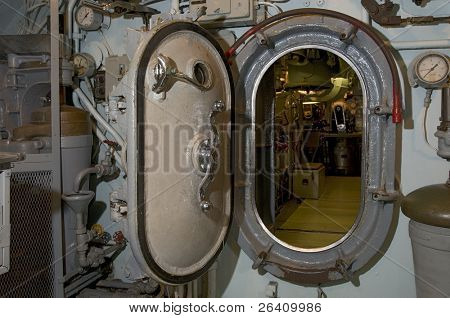 Locked submarine hatch metal door at end of hallway navy