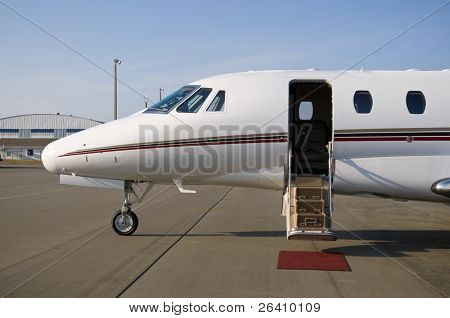 Corporate private luxury jet at airport door open