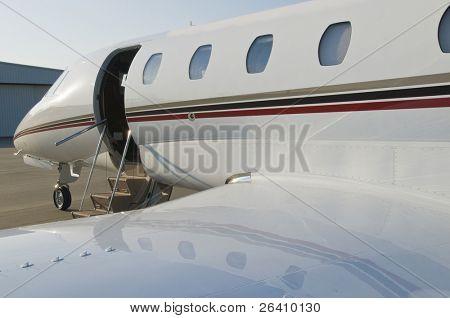 Corporate private luxury jet at airport door open