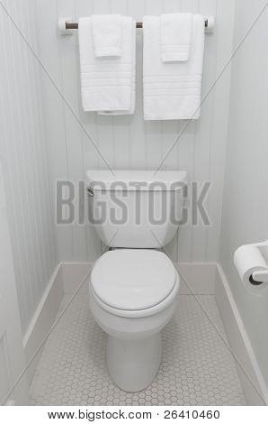 Simple white bathroom toilet lid down
