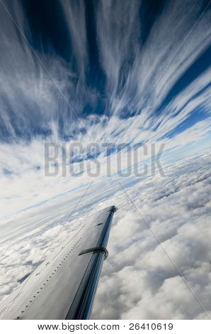 Cool cold front layered clouds in perspective blue sky