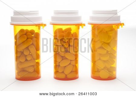 Medicine bottles with drugs isolated on white background