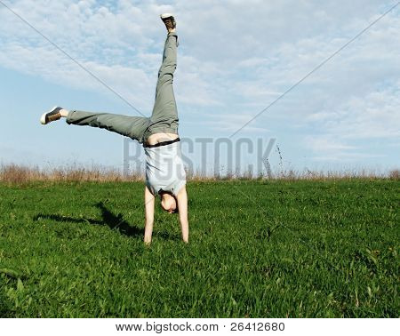 cartwheel in the nature,summer time,recreation,freedom