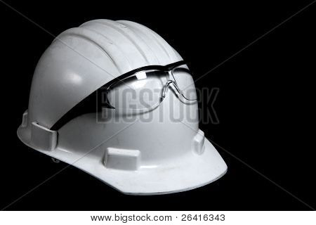 A hard hat with a pair of safty glasses