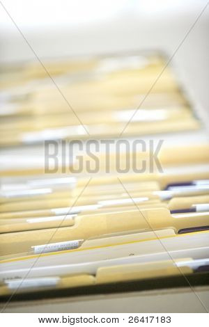 Rows of file forler filled with paperwork in an office