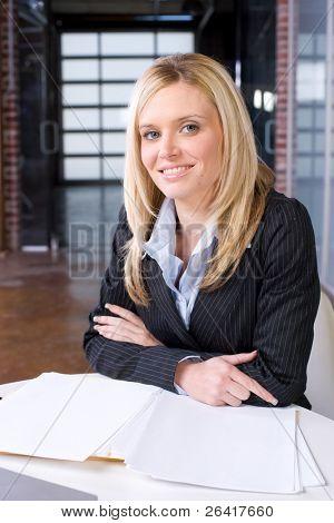 Business woman portrait in a modern office