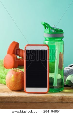 poster of Fitness Background With Bottle Of Water, Dumbbells And Smart Mobole Phone On Wooden Table. Mock Up T