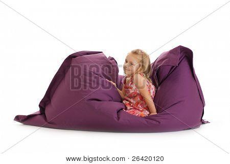 the little girl posing on beanbag