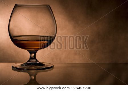 cognac glass in vintage  background