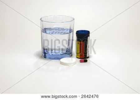 Glass Of Water With Pill