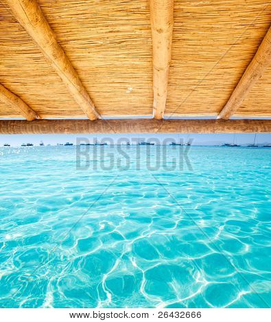 Cane sunroof with tropical perfect beach of Illetes Formentera island [Photo Illustration]