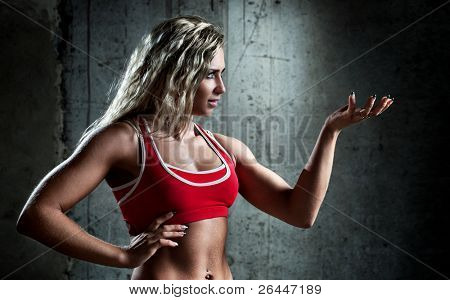 Young muscular sports woman portrait.