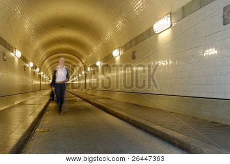 Woman is running in a tunnel