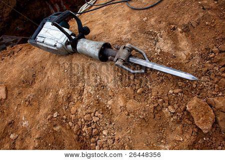 Grungy Pneumatic Hammer lying on ground
