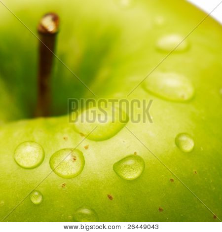 Green apple with waterdrops on its surface