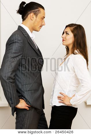 Young businessman and woman having an argument in office