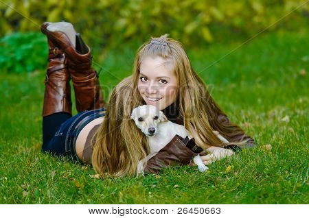 Beautiful Young Woman Hugging A Small Dog