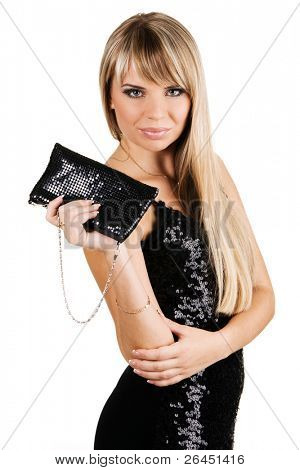 Charming young woman in black evening gown with fancy-bag