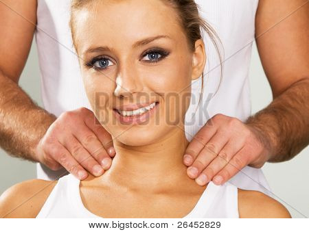Happy young woman enjoying a massage, face portrait