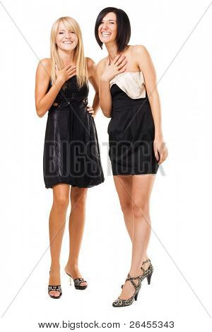 Studio portrait of two joyful elegant women, isolated on white