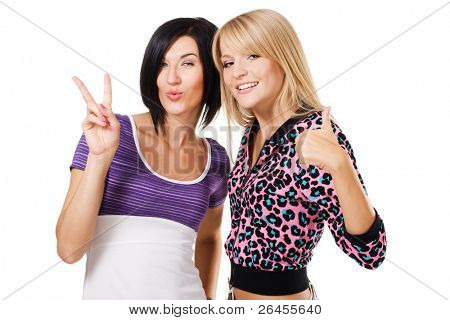 "Two young beautiful woman showing ""Thumbs up"" and ''Peace'' signs. Isolated on white background"
