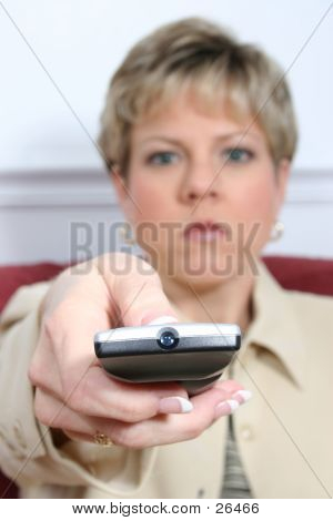 Woman Aiming Remote With Light Off