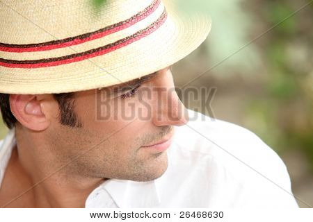 Man wearing a straw hat