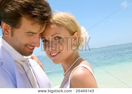 Portrait of just married couple on the beach